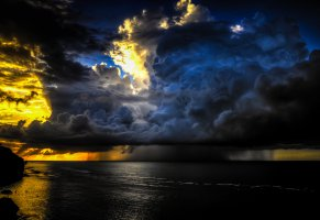 golden sunset,bali,gorgeous sky,calm ocean,pecatu,big storm
